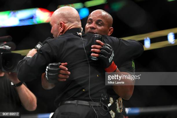 Daniel Cormier speaks to Joe Rogan after defeating Volkan Oezdemir in their Light Heavyweight Championship fight during UFC 220 at TD Garden on...