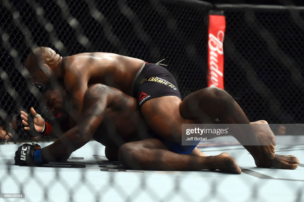 Daniel Cormier (TOP) submits Anthony Johnson in their UFC light heavyweight championship bout during the UFC 210 event at the KeyBank Center on April 8, 2017 in Buffalo, New York.