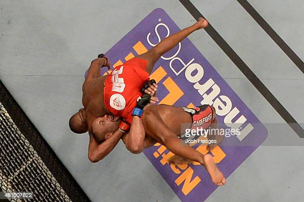 Daniel Cormier takes down Jon 'Bones' Jones in their UFC light heavyweight championship bout during the UFC 182 event at the MGM Grand Garden Arena...