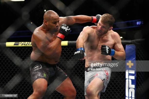Daniel Cormier throws a punch at Stipe Miocic in the first round during their UFC Heavyweight Title Bout at UFC 241 at Honda Center on August 17,...