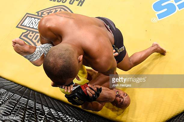 Daniel Cormier wrestles with Anderson Silva of Brazil in their light heavyweight bout during the UFC 200 event on July 9, 2016 at T-Mobile Arena in...