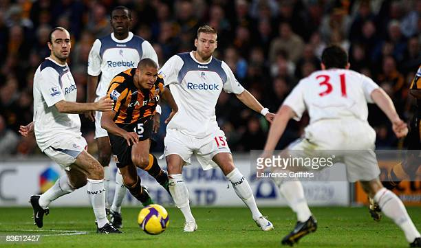 Daniel Cousin of Hull battles with Gavin McCann Fabrice Muamba Gretar Steinnson and Andrew O'Brien of Bolton during the Barclays Premier League match...
