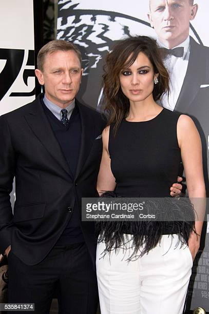 Daniel Craig and Berenice Marlohe pose during the photocall for the movie Skyfall at Hotel George V in Paris