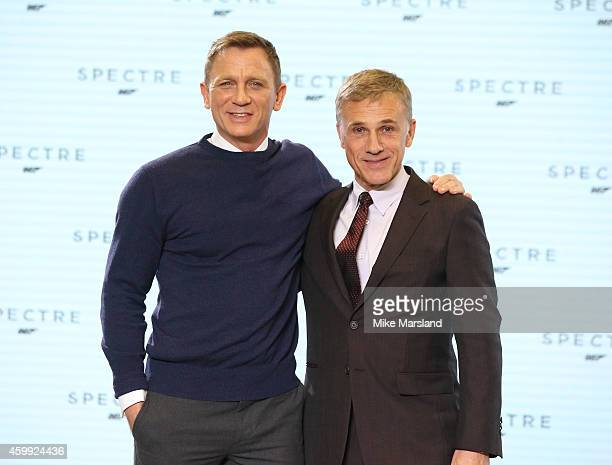Daniel Craig and Christoph Waltz attend a photocall for Bond 24 at Pinewood Studios on December 4 2014 in Iver Heath England