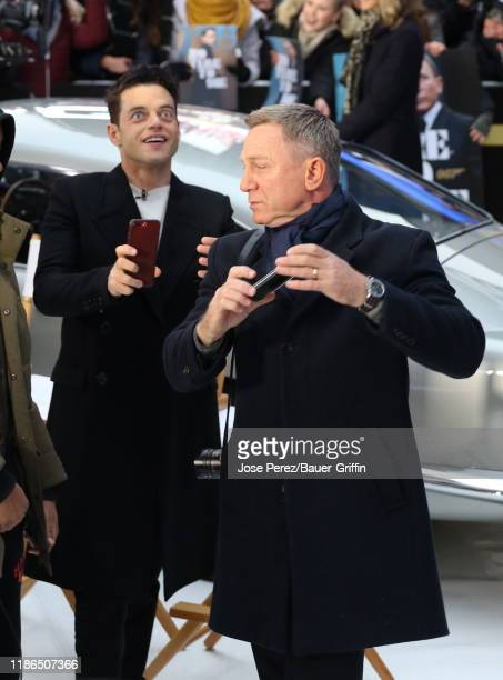 Daniel Craig and Rami Malek are seen at Times Square on December 04 2019 in New York City