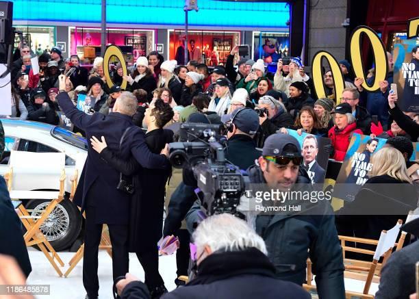 Daniel Craig and Rami Malek pose for a selfie outside Good Morning America on December 4 2019 in New York City