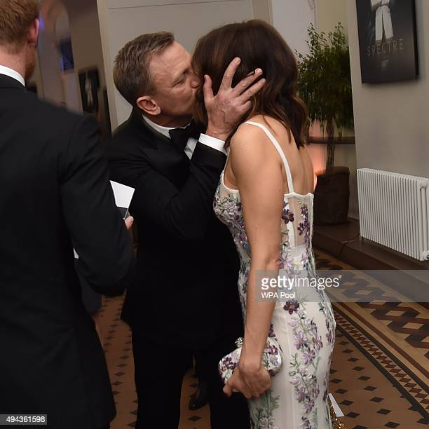 Daniel Craig kisses his wife actress Rachel Weisz while they attend The Cinema and Television Benevolent Fund's Royal Film Performance 2015 of the...