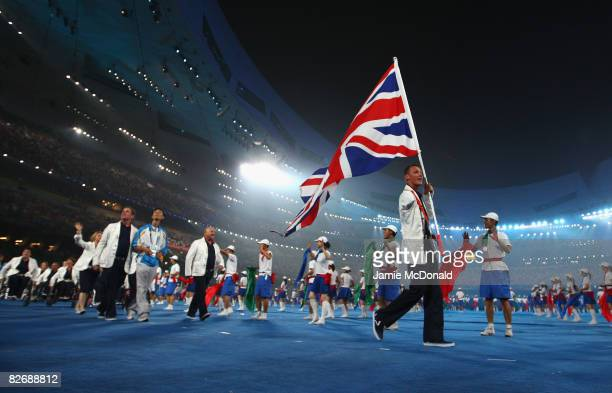 Daniel Crates of the GB Athletics Team walks with the British flag during the Opening Ceremony for the Beijing 2008 Paralympic Games at the National...