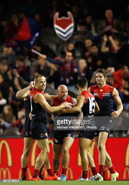 Daniel Cross Nathan Jones and Billy Stretch of the Demons celebrate during the 2015 AFL round 23 match between the Melbourne Demons and the GWS...