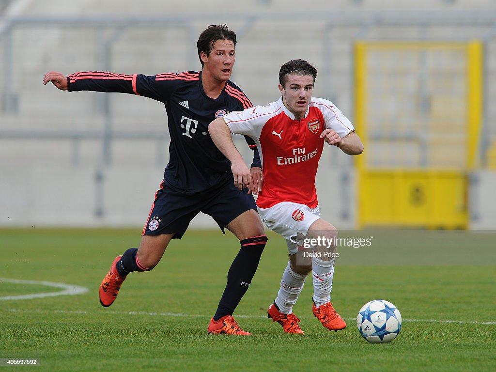 Daniel Crowley of Arsenal takes on Fabian Benko of Bayern looks on during the match between Bayern Munich U19 and Arsenal U19 at Grunwalder Stadion on November 4, 2015 in Munich, Bavaria.