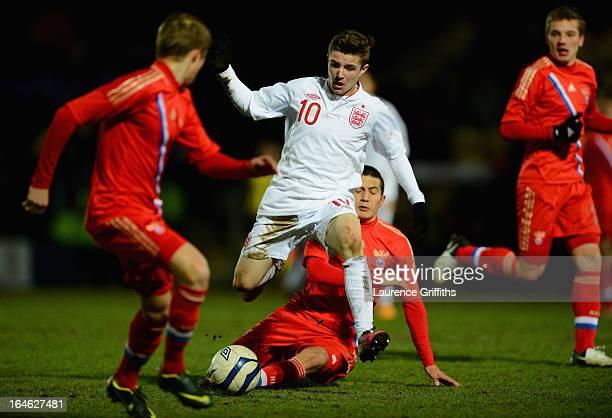 Daniel Crowley of England battles with Dzhamaldin Khodzhaniiazov of Russia during the UEFA European Under17 Championship Elite Round match between...