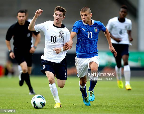 Daniel Crowley of England holds off pressure from Nicolo Barella of Italy during an International Friendly between England U17 and Italy U17 at The...