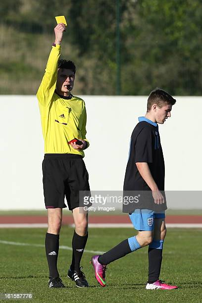 Daniel Crowley of England receives a yellow card during the Under17 Algarve Youth Cup match between U17 England and U17 Germany at the Estadio...