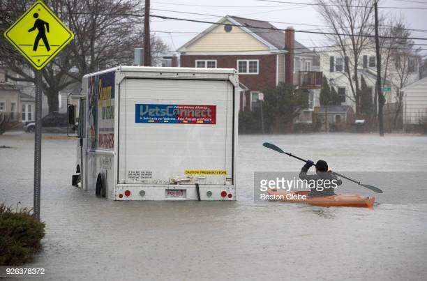 Daniel Cunningham of Quincy kayaks out to check on a stranded driver in the flooded Squantum section of Quincy MA during a nor'easter storm on March...