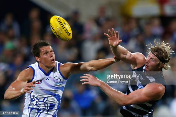 Daniel Currie of North Melbourne and Dawson Simpson of Geelong compete in the ruck during the AFL Practice Match between the Geelong Cats and the...