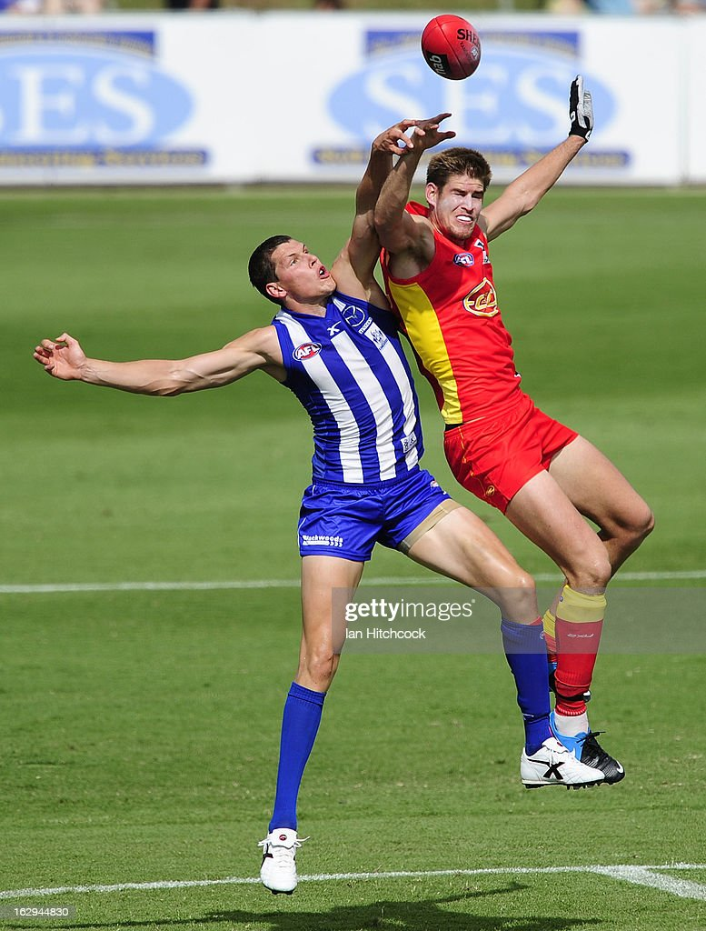 Daniel Currie of the Kangaroos and Zac Smith of the Suns contests the ball during the round two AFL NAB Cup match between the Gold Coast Suns and the North Melbourne Kangaroos at Tony Ireland Stadium on March 2, 2013 in Townsville, Australia.