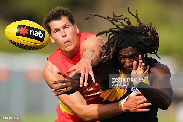 Daniel Currie of the Suns and Nic Naitanui of the Eagles contest the ruck during the 2016 AFL NAB Challenge match between the West Coast Eagles and...