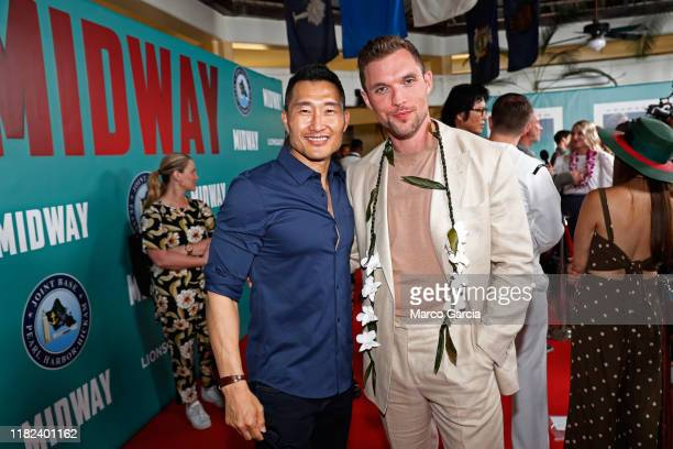Daniel Dae Kim and Ed Skrein arrive at the Midway Special Screening at Joint Base Pearl HarborHickam on October 20 2019 in Honolulu Hawaii