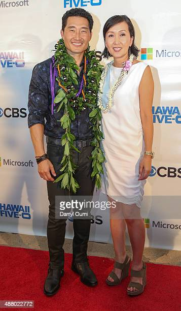 Daniel Dae Kim and his wife Laura Kim arrive at the CBS 'Hawaii Five0' Sunset On The Beach Season 6 Premire Event at Queen's Surf Beach on September...