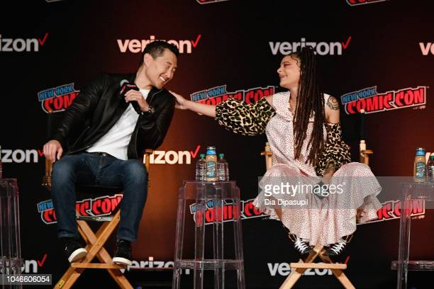 Daniel Dae Kim and Sasha Lane speak onstage at the Hellboy panel during New York Comic Con at Jacob Javits Center on October 6 2018 in New York City