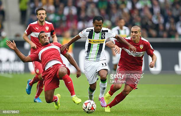 Daniel Davari and Oriol Romeu of Stuttgart challenge Raffael of Moenchengladbach during the Bundesliga match between Borussia Moenchengladbach and...