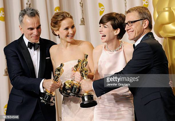 Daniel Day-Lewis, Jennifer Lawrence, Anne Hathaway and Christophe Waltz in the press room during the 85th Annual Academy Awards held at the Loews...