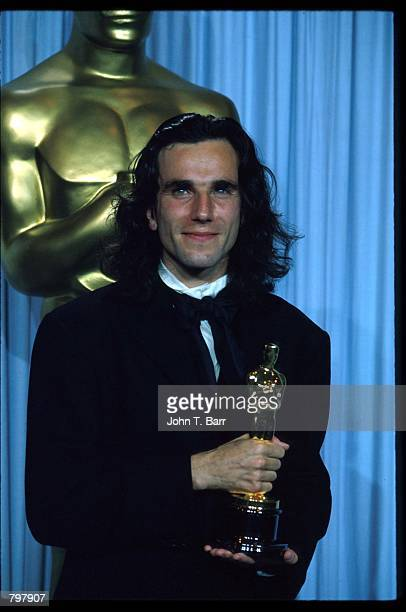 Daniel DayLewis stands backstage during the 62nd Academy Awards ceremony March 26 1990 in Los Angeles CA Daniel DayLewis received an Oscar for Best...