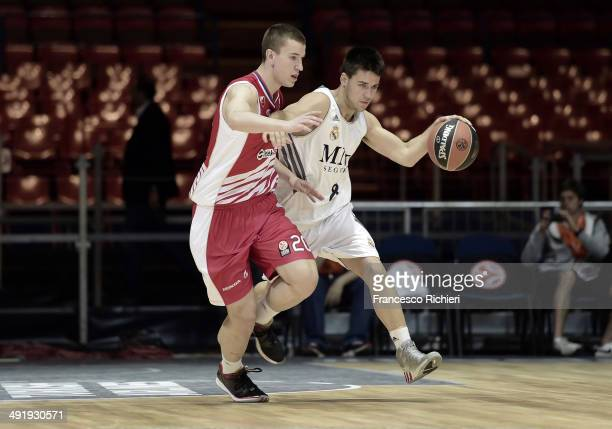 Daniel De la Rua, #8 of Real Madrid competes with Aleksander Aranitovic, #20 of Crvena Zvedza Telekom Belgrado in during the Nike International...