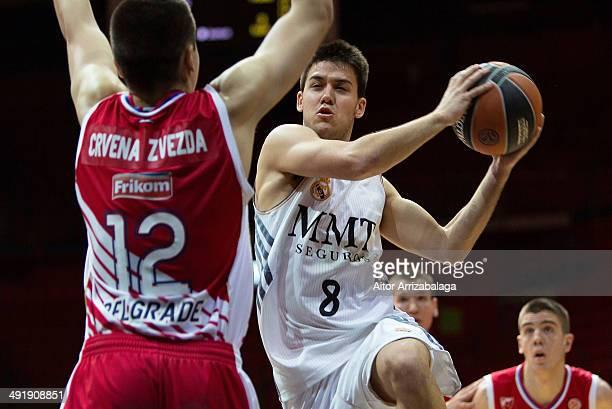 Daniel de la Rua, #8 of Real Madrid competes with Bratislav Jekovic, #12 of Crvena Zvezda TelekomcoBelgrade during the Nike International Junior...