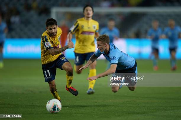 Daniel De Silva of the Central Coast Mariners contests the ball against Trent Buhagiar of Sydney FC during the round 20 A-League match between the...