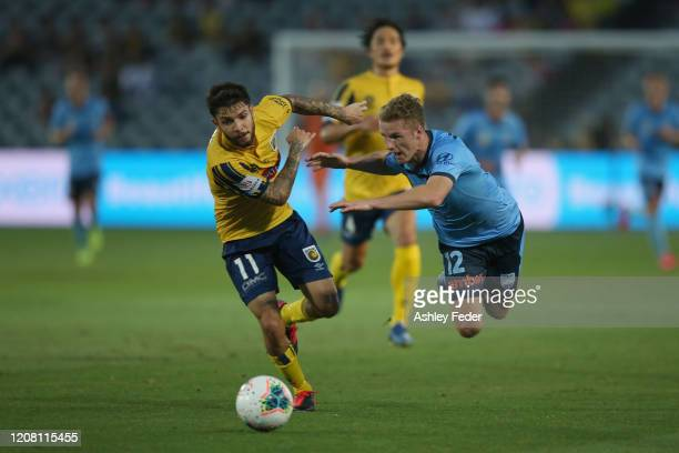 Daniel De Silva of the Central Coast Mariners contests the ball against Trent Buhagiar of Sydney FC during the round 20 ALeague match between the...