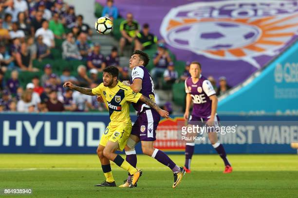 Daniel De Silva of the Mariners and Brandon Wilson of the Glory conetest for the ball during the round three ALeague match between Perth Glory and...