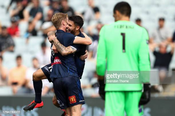 Daniel De Silva of the Mariners celebrates scoring a goal with team mate Matt Simon during the A-League match between Macarthur FC and the Central...