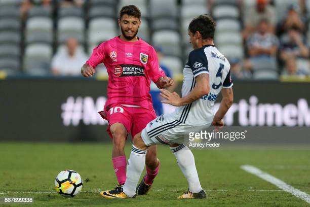 Daniel De Silva of the Mariners contests the ball against Mark Milligan of the Victory during the round four ALeague match between the Central Coast...