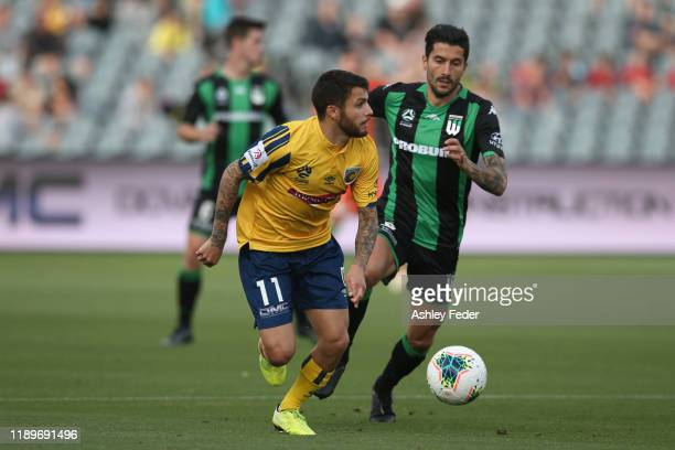 Daniel De Silva of the Mariners contests the ball against Panagiotis Kone of Western United during the round 7 ALeague match between the Central...