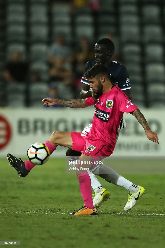 Daniel De Silva of the Mariners contests the ball against Thomas Deng of the Victory during the round four A-League match between the Central Coast Mariners and the Melbourne Victory at Central Coast Stadium on October 29, 2017 in Gosford, Australia.