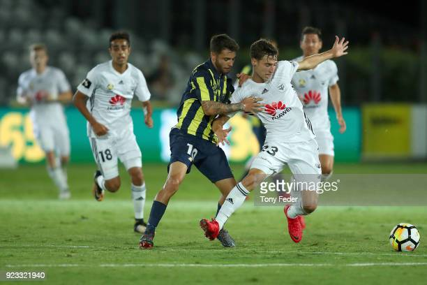 Daniel De Silva of the Mariners contests the ball with Matthew Ridenton of the Phoenix during the round 21 ALeague match between the Central Coast...