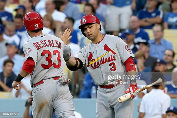 Daniel Descalso celebrates with Carlos Beltran of the St Louis Cardinals after Descalso scores in the third inning against the Los Angeles Dodgers in...