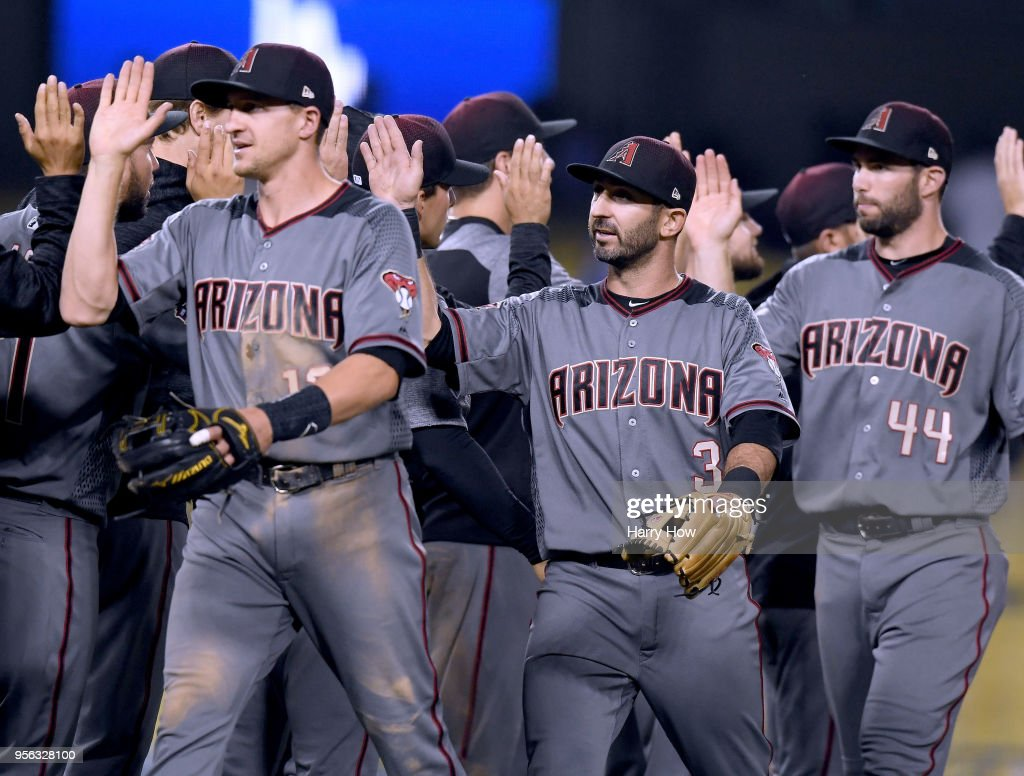 Daniel Descalso #3 of the Arizona Diamondbacks celebates an 8-5 win over the Los Angeles Dodgers after his three run homerun in the 12th inning at Dodger Stadium on May 8, 2018 in Los Angeles, California.