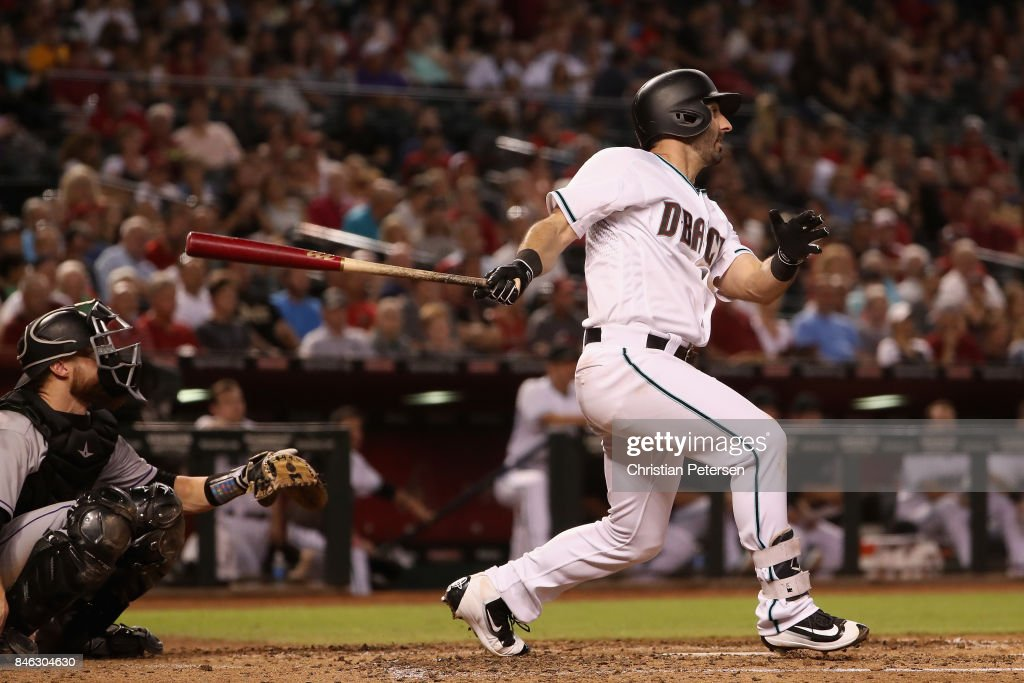 Daniel Descalso #3 of the Arizona Diamondbacks hits a single against the Colorado Rockies during the fourth inning of the MLB game at Chase Field on September 12, 2017 in Phoenix, Arizona.