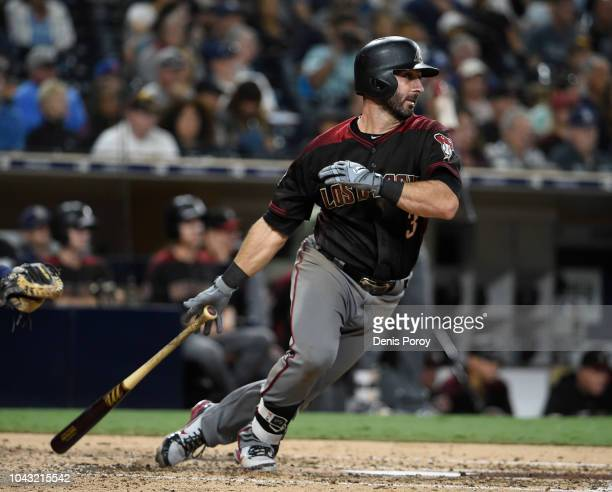 Daniel Descalso of the Arizona Diamondbacks hits a single during the sixth inning of a baseball game against the San Diego Padres at PETCO Park on...