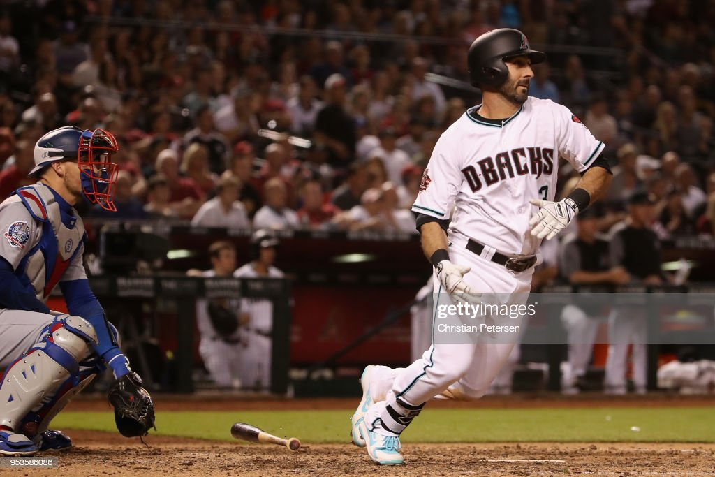 Daniel Descalso #3 of the Arizona Diamondbacks hits a two-run triple against the Los Angeles Dodgers during the seventh inning of the MLB game at Chase Field on May 1, 2018 in Phoenix, Arizona.