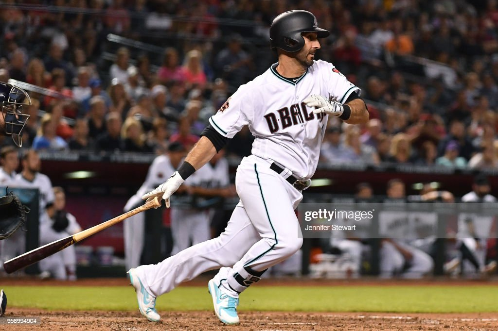 Daniel Descalso #3 of the Arizona Diamondbacks hits an RBI single in the eighth inning of the MLB game against the Milwaukee Brewers at Chase Field on May 15, 2018 in Phoenix, Arizona.
