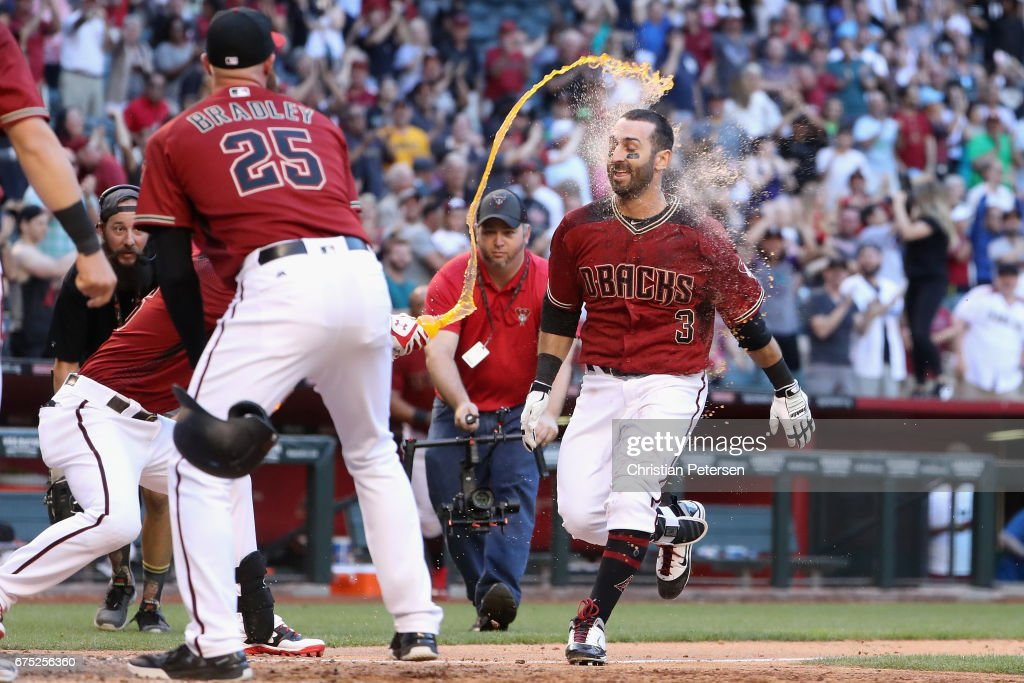 Daniel Descalso #3 of the Arizona Diamondbacks is congratulated at home plate by teammates after hiting a two run home run to defeat the Colorado Rockies 2-0 in the 13th inning of the MLB game at Chase Field on April 30, 2017 in Phoenix, Arizona.