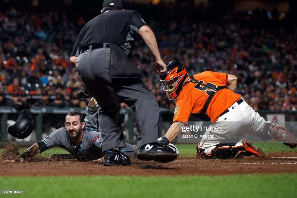 Daniel Descalso #3 of the Arizona Diamondbacks is tagged out at home plate by Nick Hundley #5 of the San Francisco Giants in front of umpire Doug Eddings #88 during the second inning at AT&T Park on September 15, 2017 in San Francisco, California.