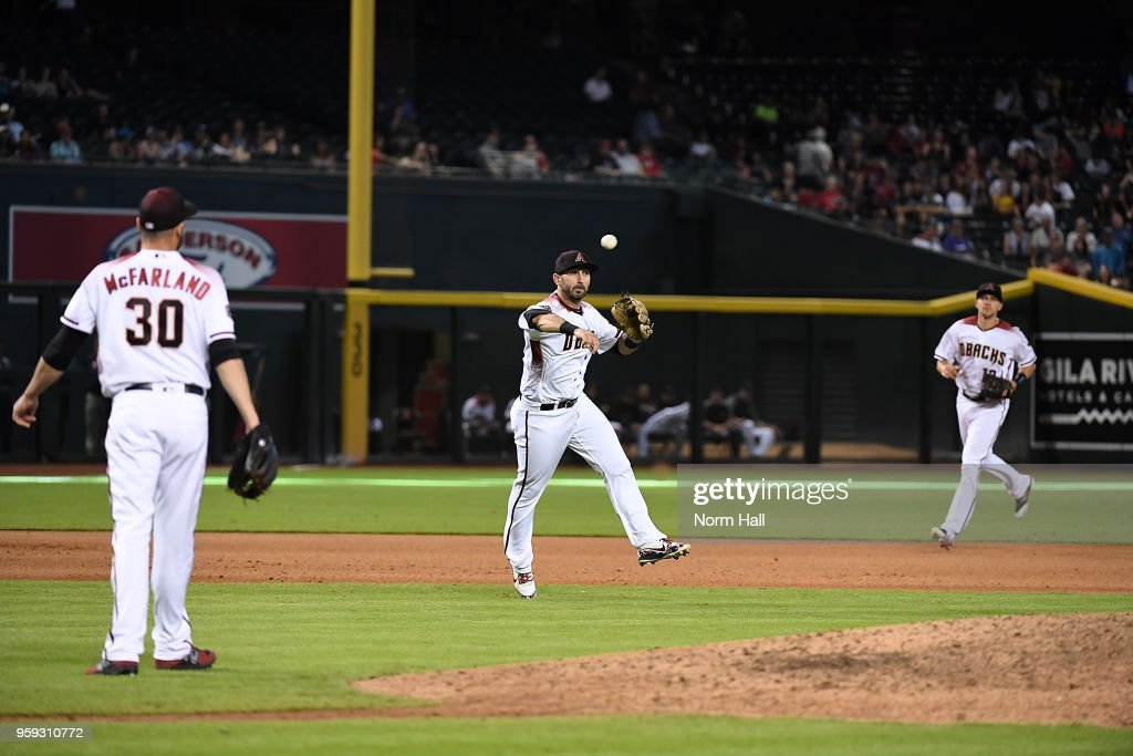 Daniel Descalso #3 of the Arizona Diamondbacks makes a play on a bouncing ball during the seventh inning against the Milwaukee Brewers at Chase Field on May 16, 2018 in Phoenix, Arizona. Brewers won 8-2.