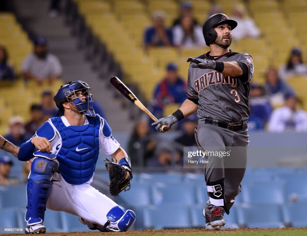 Daniel Descalso #3 of the Arizona Diamondbacks reacts to his three run homerun in front of Kyle Farmer #17 of the Los Angeles Dodgers, to take an 8-5 lead during the 12th inning at Dodger Stadium on May 8, 2018 in Los Angeles, California.