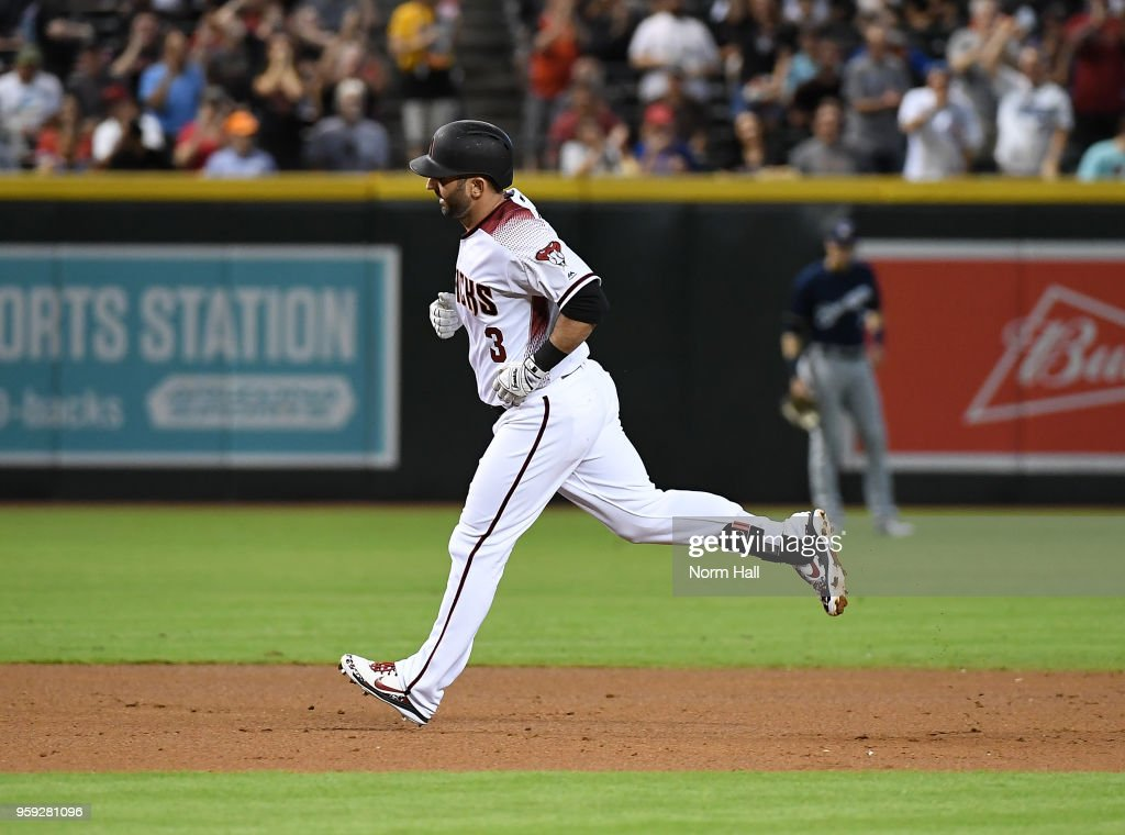 Daniel Descalso #3 of the Arizona Diamondbacks rounds the bases after hitting a two run home run against the Milwaukee Brewers during the first inning at Chase Field on May 16, 2018 in Phoenix, Arizona.