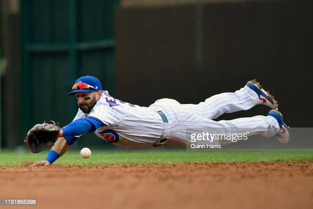 Daniel Descalso of the Chicago Cubs dives for the ball in the third inning against the Cincinnati Reds at Wrigley Field on May 26 2019 in Chicago...