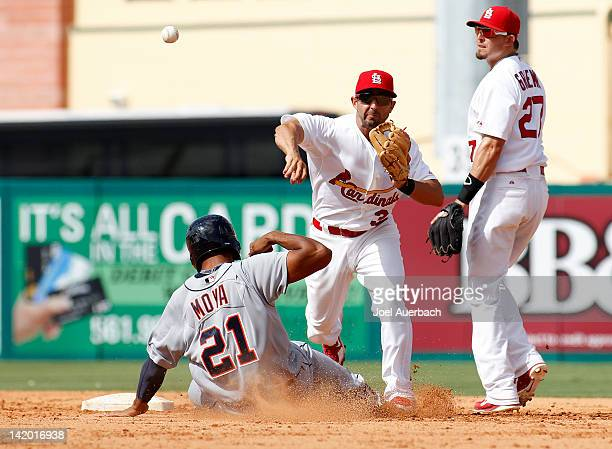 Daniel Descalso of the St. Louis Cardinals turns the double play getting Steven Moya out at second and Danny Worth of the Detroit Tigers out at first...